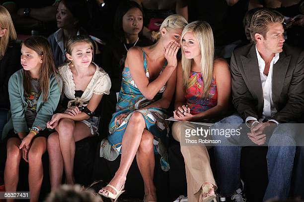 Socialite Paris Hilton sits in the front row at the Tommy Hilfiger Spring 2006 fashion show during Olympus Fashion Week at Bryant Park September 9...