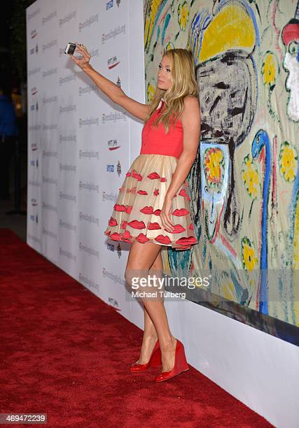 "Socialite Paris Hilton takes a selfie at the Mending Kids International's ""Rock & Roll All-Stars"" Fundraising Event on February 14, 2014 in..."