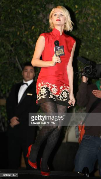 US socialite Paris Hilton wearing a Chinese style qipao dress poses for the Chinese media at a press conference in Shanghai 22 November 2007 Hilton...