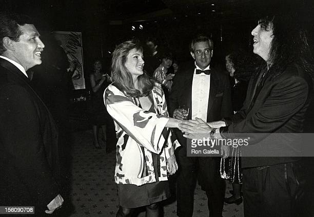Socialite Patty Hearst husband Bernard Shaw and musician Paul Stanley of Kiss attending 35th Anniversary Gala for Playboy Magazine on December 1 1988...