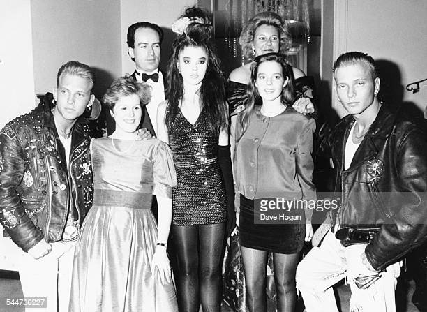 Socialite Tamara Beckwith with Matt and Luke Goss of the band 'Bros' posing with other guests at a charity ball in London April 12th 1989