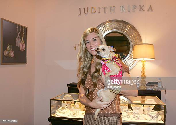 Socialite Tinsley Mortimer is seen carrying Lucy Anne in the Judith Ripka booth in the lobby of the main tent during Olympus Fashion Week Fall 2005...