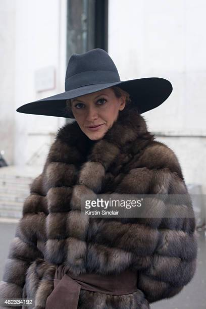 Socialite Ulla Parker wears a Saint Laurent hat Milady fur coat Charlotte Olympia clutch on day 2 of Paris Haute Couture Fashion Week Spring/Summer...