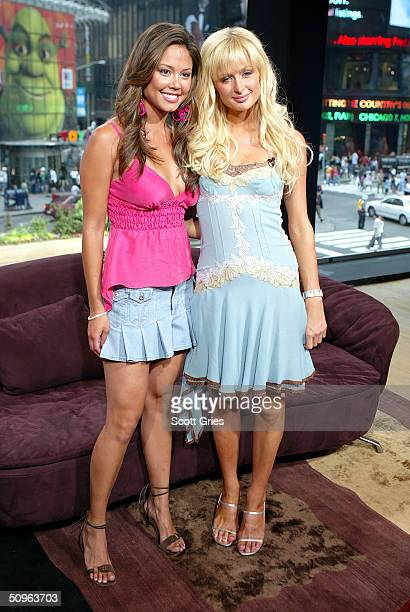 Socialite/actress Paris Hilton and VJ Vanessa Minnillo pose for a photo backstage during MTV's Total Request Live at the MTV Times Square Studios...