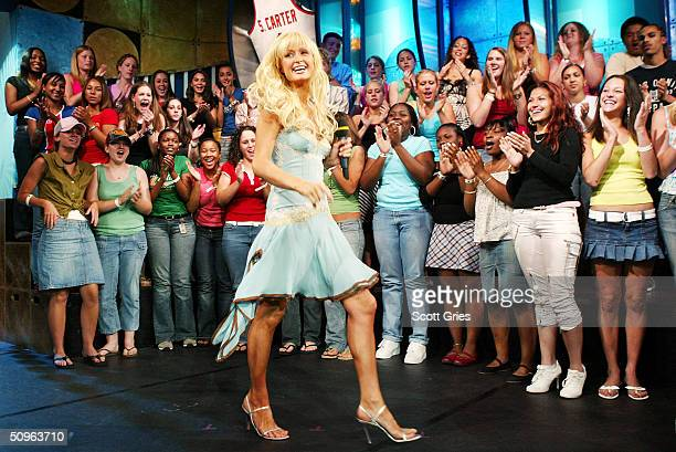 Socialite/actress Paris Hilton appears on stage during MTV's Total Request Live at the MTV Times Square Studios June 15 2004 in New York City