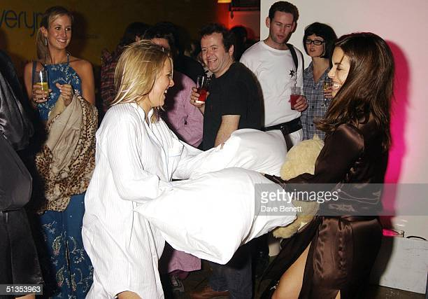 Socialites Alice Bamford and Jessica De Rothschild have a pillow fight at a pyjama party held to raise funds for Everyman The Institute of Cancer...
