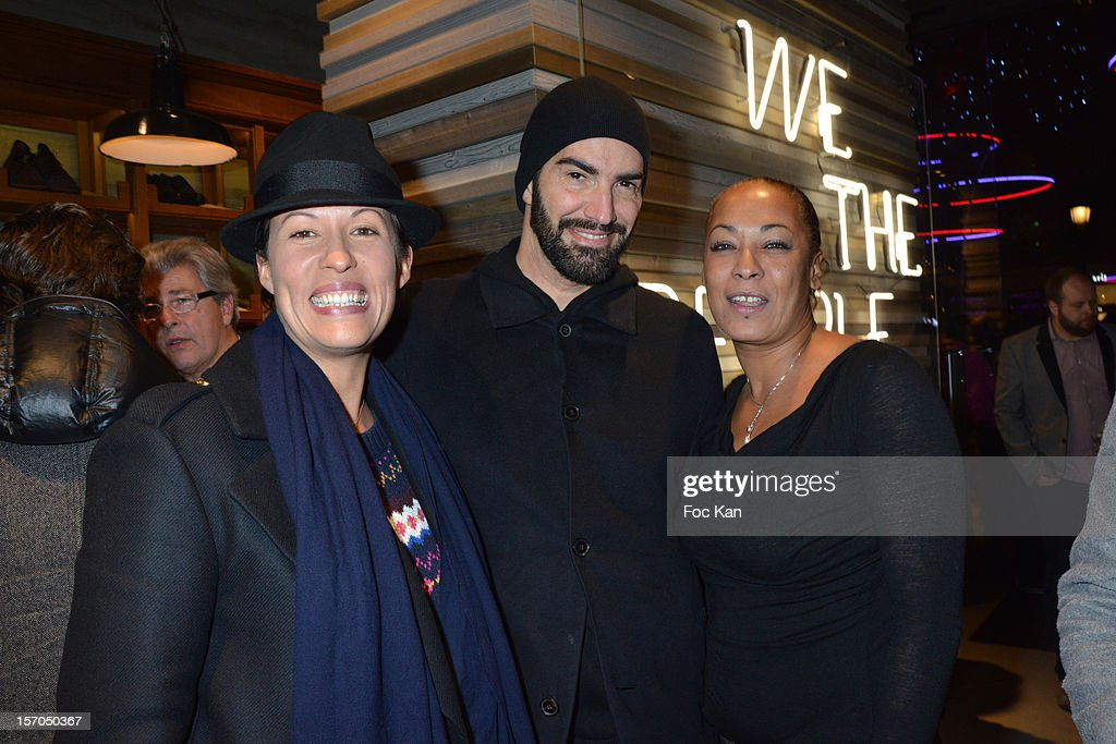 Socialites Karine Martin, Mickael de la Selva and Katy Rau attend the MCS 'We The People' launch party at MCS Champs Elysees on November 27, 2012 in Paris, France.