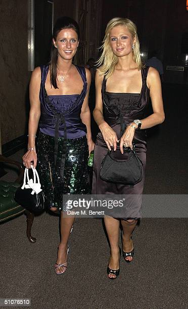 Socialites Nicky and Paris Hilton inside the Prada Beverly Hills store opening night party on July 15 2004 in Beverly Hills California
