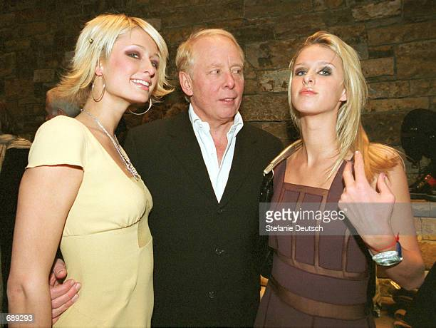 Socialites Paris and Nicky Hilton join Caribou Club owner Harley Baldwin at the Prada grand opening December 29 in Aspen CO