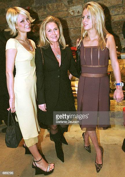 Socialites Paris and Nicky Hilton join their mother Kathy for the grand opening of Prada December 29 2001 in Aspen CO