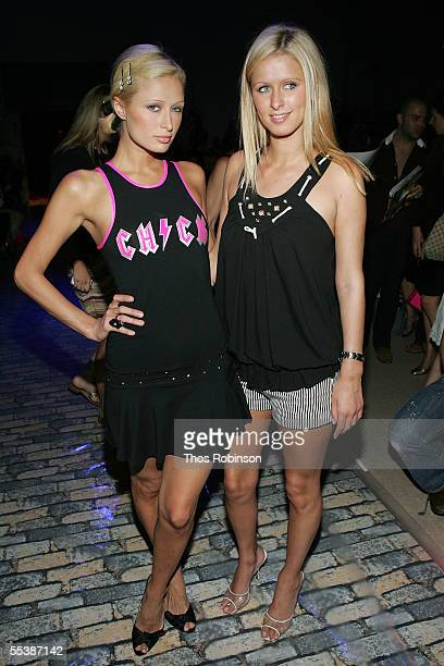 Socialites Paris Hilton and Nicky Hilton attend the Betsey Johnson Spring 2006 fashion show during Olympus Fashion Week at Bryant Park September 12...