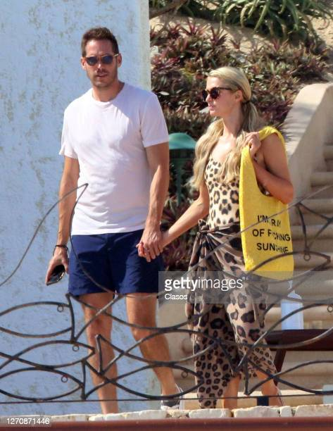 Socialite-turned-DJ Paris Hilton and her boyfriend Carter Reum, a 39-year-old businessman walk in their luxurious resortas during their holiday on...