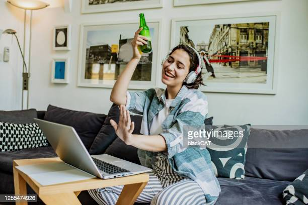 socializing at home via video call - party conference stock pictures, royalty-free photos & images