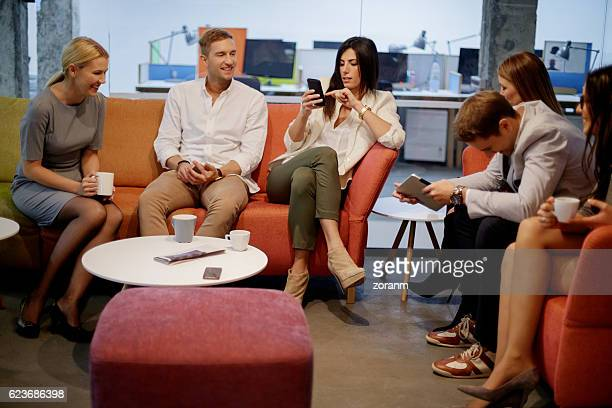 socializing on a coffee break - convenience stock photos and pictures