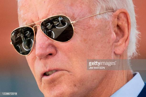 Socially distanced attendees are reflected in Democratic presidential candidate Joe Biden's sunglasses as he speaks at the Black Economic Summit at...