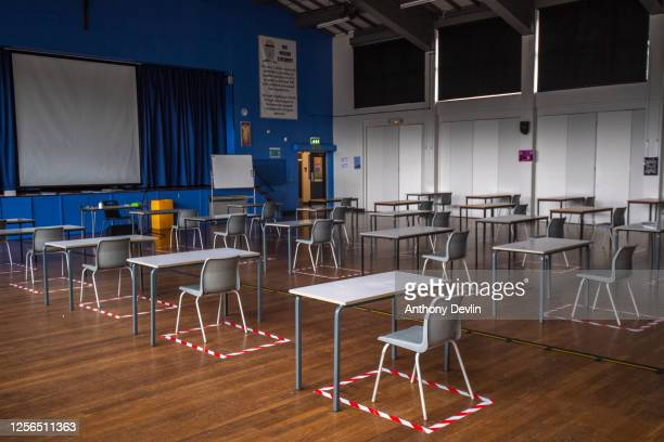 Socially distanced deks are set out for lesson in the hall at All Saints Catholic College on July 16, 2020 in Dukinfield, England. The Government...