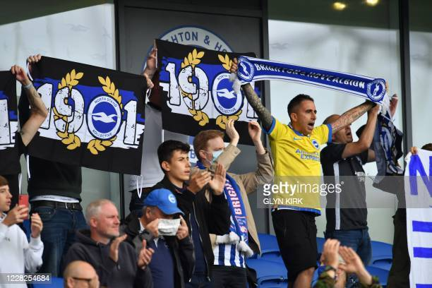 Socially distanced fans cheer players and manager from the stands after the pre-season friendly football match between Brighton and Hove Albion and...