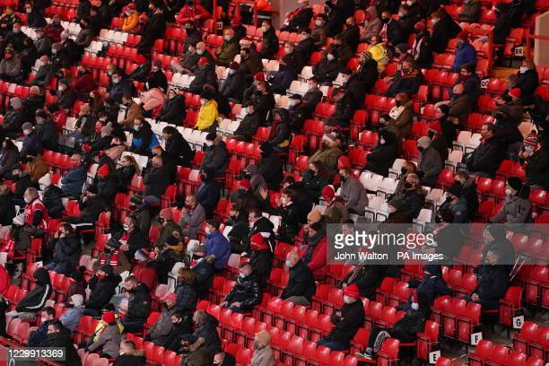 Socially distanced fans in the stands watch the action during the Sky Bet Championship match at The Valley, London.