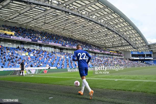 Socially distanced fans watch from the stands as Chelsea's Moroccan midfielder Hakim Ziyech goes to take a corner during the pre-season friendly...
