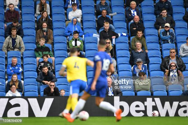 Socially distanced fans watch from the stands during the preseason friendly football match between Brighton and Hove Albion and Chelsea at the...