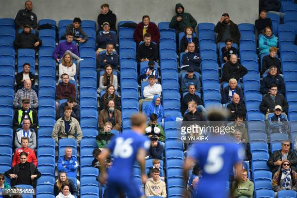 Socially distanced fans watch from the stands during the pre-season friendly football match between Brighton and Hove Albion and Chelsea at the...