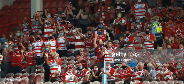 Socially distanced Gloucester fans only a thousand who were allowed in welcome the teams onto the pitch during the Gallagher Premiership Rugby match...