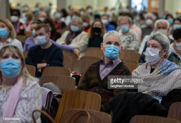 Socially distanced worshippers attend Sunday mass at the evangelical Christian Open Door Church on February 21, 2021 in Mulhouse, eastern France. A...