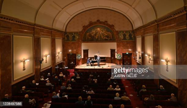 Socially-distanced members of the audience listen to a performance by German baritone Christian Gerhaher and German pianist Gerold Huber at Wigmore...