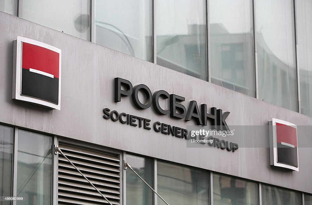 A Societe Generale Group logo stands on display outside an OAO Rosbank bank branch in Moscow, Russia, on Tuesday, April 22, 2014. Bankers collected $108 million on Russian deals through April 20, compared with $325 million a year earlier, according to data from Freeman & Co., a New York consulting firm. Photographer: Andrey Rudakov/Bloomberg via Getty Images