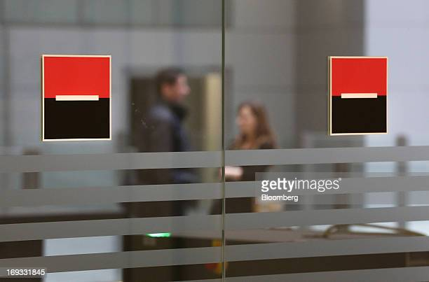 Societe Generale logos sit on glass panels at a bank branch inside the headquarters of OAO Rosbank in Moscow Russia on Thursday May 23 2013 Societe...