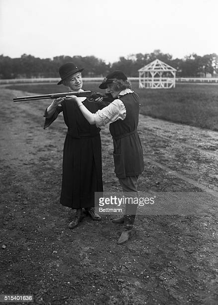Society Circus Rehearsal at Mineola Long Island Mineola Long Island New York Miss Annie Oakley teaches Dorothy daughter of Mr and Mrs Fred Stone how...