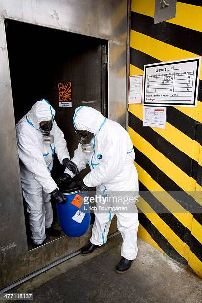 Society for the disposal of chemical warfare agents and military sites Our picture shows employees of GEKA in protectice suits and a barrel with...