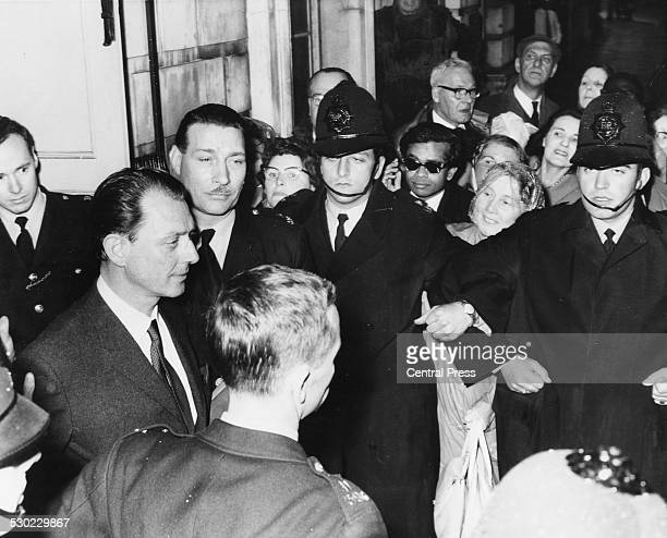 Society osteopath Dr Stephen Ward a leading figure in the Profumo Affair flanked by policeman as he leaves Marylebone Magistrates Court London June...
