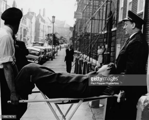 Society osteopath Stephen Ward is taken in a coma from a flat in Mallord Street Chelsea to St Stephen's Hospital London 31st July 1963 Ward took an...