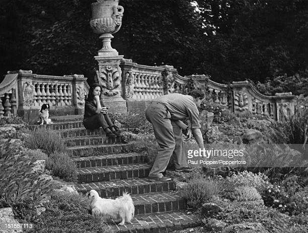 Society osteopath Stephen Ward with a friend at his cottage on Lord Astor's estate at Cliveden Buckinghamshire circa 1963 Ward committed suicide on...