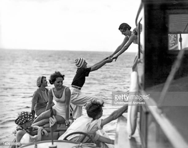 Society women board a fishing cruiser at the Key Largo Anglers Club Miami Florida 1920s