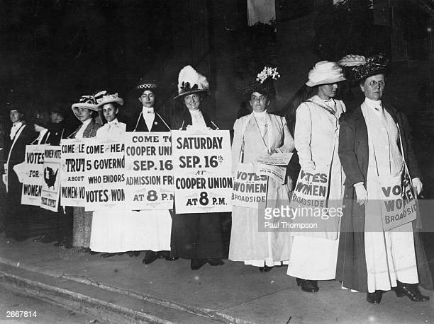 Society women wearing sandwich boards to publicise a talk at Cooper Union by the governors of the states which have granted the vote to women