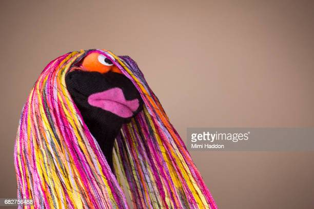 sock puppet with big pink lips and multi colored hair - big lips stock photos and pictures