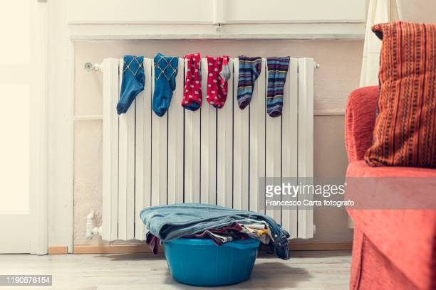 socks on radiator - wet knickers stock pictures, royalty-free photos & images