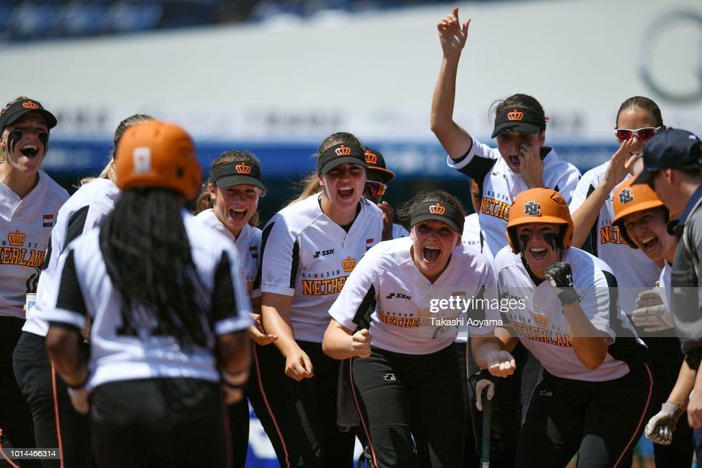 Soclaina Naphtalini Van Gurp #11 of Netherlands celebrates as she rounds the bases after hitting solo home run in the second inning against Canada during their Playoff Round at ZOZO Marine Stadium on day nine of the WBSC Women's Softball World Championship on August 10, 2018 in Chiba, Japan.