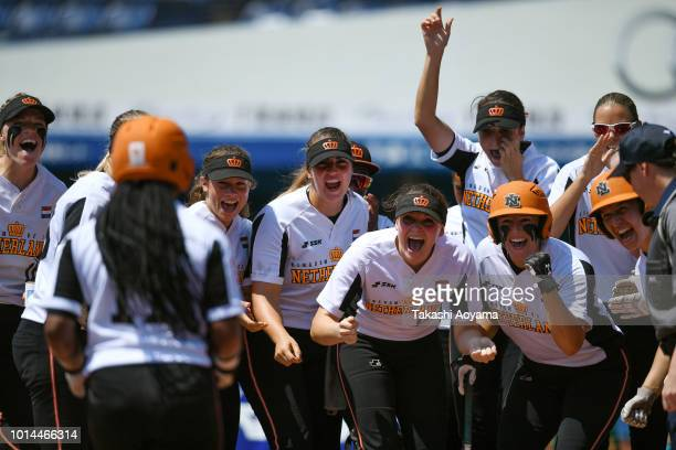 Soclaina Naphtalini Van Gurp of Netherlands celebrates as she rounds the bases after hitting solo home run in the second inning against Canada during...