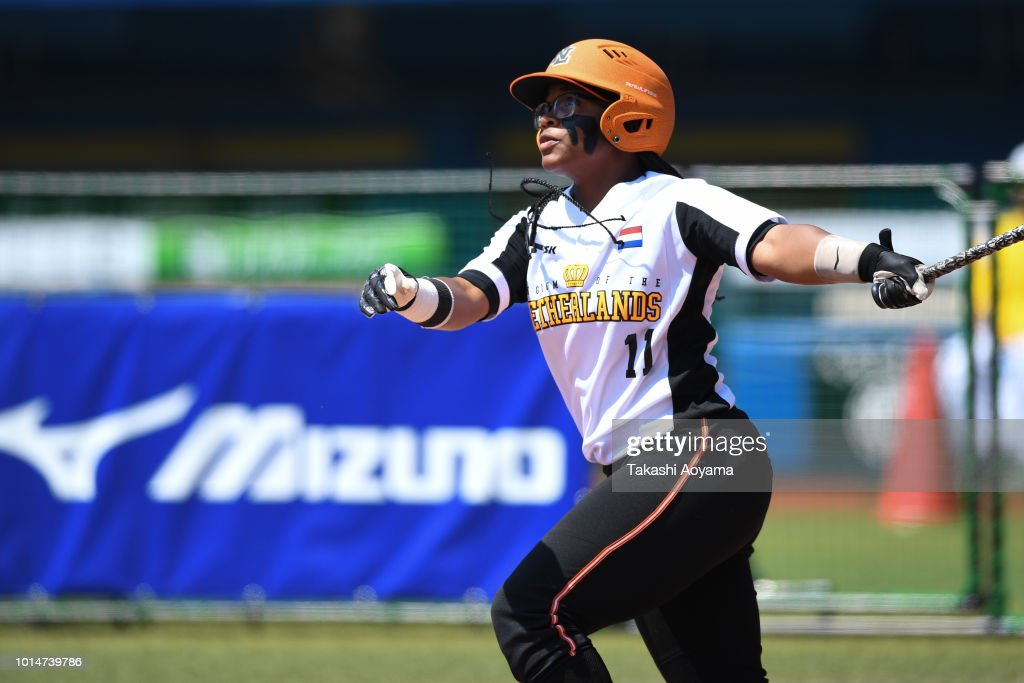 Soclaina Naphtalini Van Gurp #11 of Netherlands hits solo home run in the second inning against Canada during their Playoff Round at ZOZO Marine Stadium on day nine of the WBSC Women's Softball World Championship on August 10, 2018 in Chiba, Japan.