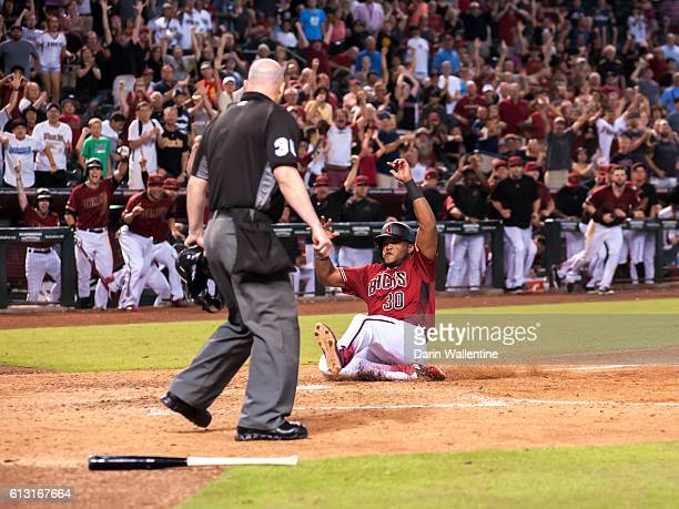 Socrates Brito of the Arizona Diamondbacks slides home safely to score the winning run in the ninth inning of the MLB game against the San Diego...