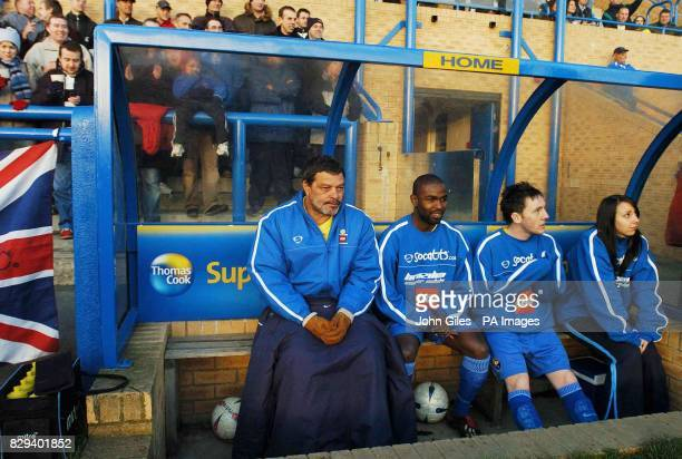 Socrates sits on the bench amongst his new teammates at Garforth Town football ground near Leeds Saturday November 20 where the former Brazilian...