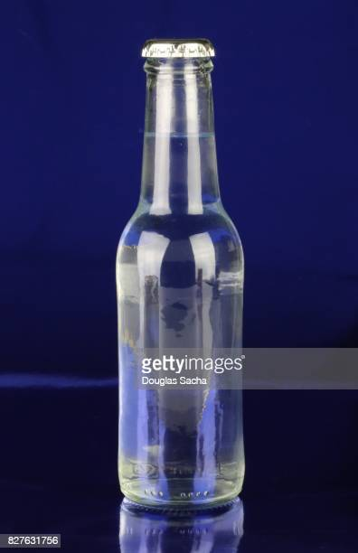 soda bottle on a blue background - soda bottle stock photos and pictures