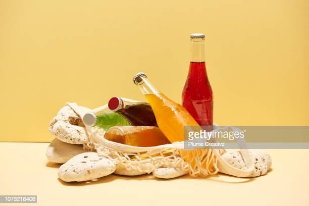 Soda bottles in mesh bag