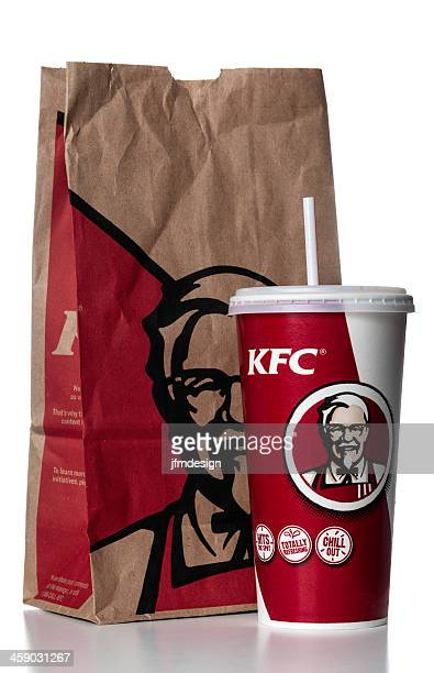 kfc soda cup with take out bag - kentucky fried chicken stock photos and pictures