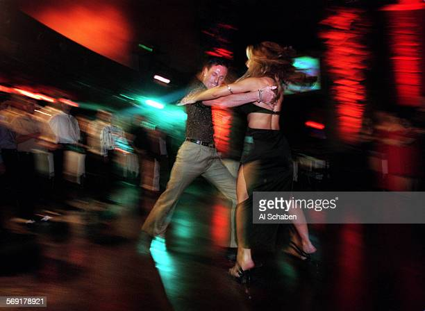 SOdancersmayan1204AS––LOS ANGELES––THE MAYAN––Salsa dance instructors Josie Neglia right and Peta Siddall demonstrate a move while instructing...