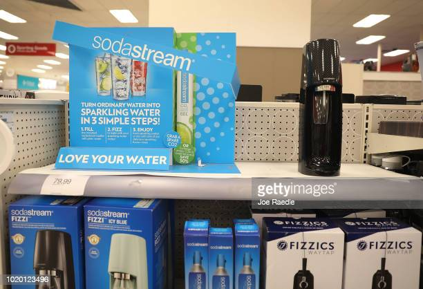 SodaStream products are displayed for sale on a store shelf on August 20 2018 in Miami Florida PepsiCo Inc announced it plans on buying SodaStream...
