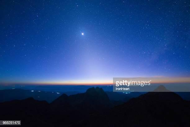 sodiac astronomy landscape view. - alba crepuscolo foto e immagini stock